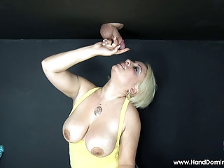 blonde with big fat tits sucks small cock through gloryhole